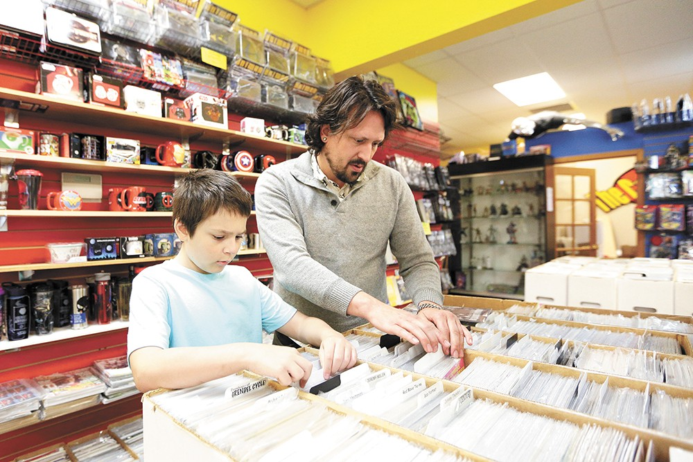 Ace Geiger, 12, and his father, Thomas, browse at the Comic Book Shop on Saturday. - YOUNG KWAK PHOTO