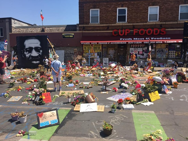 Memorials to George Floyd outside the Minneapolis convenience store where he was killed. - MATT SLATER