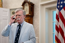 Then National Security Advisor John Bolton in the Oval Office in Washington, July 19, 2019. More than two months before he asked Ukraine's president to investigate his political opponents, Trump directed John Bolton to help extract damaging information on Democrats from Ukrainian officials, according to Bolton's unpublished manuscript. - ERIN SCHAFF/THE NEW YORK TIMES