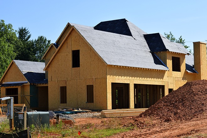 Home builders still have to follow a raft of coronavirus safety rules, including keeping 6 feet apart and wearing masks and goggles.