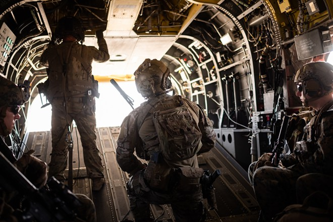 Members of the American military in a helicopter over Helmand province, Afghanistan, Sept. 26, 2019. United States intelligence officers and Special Operations forces in Afghanistan alerted their superiors as early as January to a suspected Russian plot to pay bounties to the Taliban to kill American troops in Afghanistan, according to officials briefed on the matter. - JIM HUYLEBROEK/THE NEW YORK TIMES