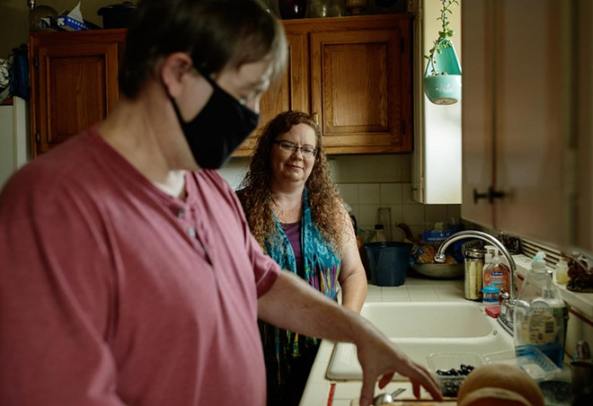 Daryle Garnder makes lunch for his wife Sara Gardner at their home in Spokane, Washington. Sara lost in her job due to the pandemic and was supporting her and her husband on a $600 unemployment check. Last month she got a letter which said she owed much of the money back. - RAJAH BOSE FOR CROSSCUT