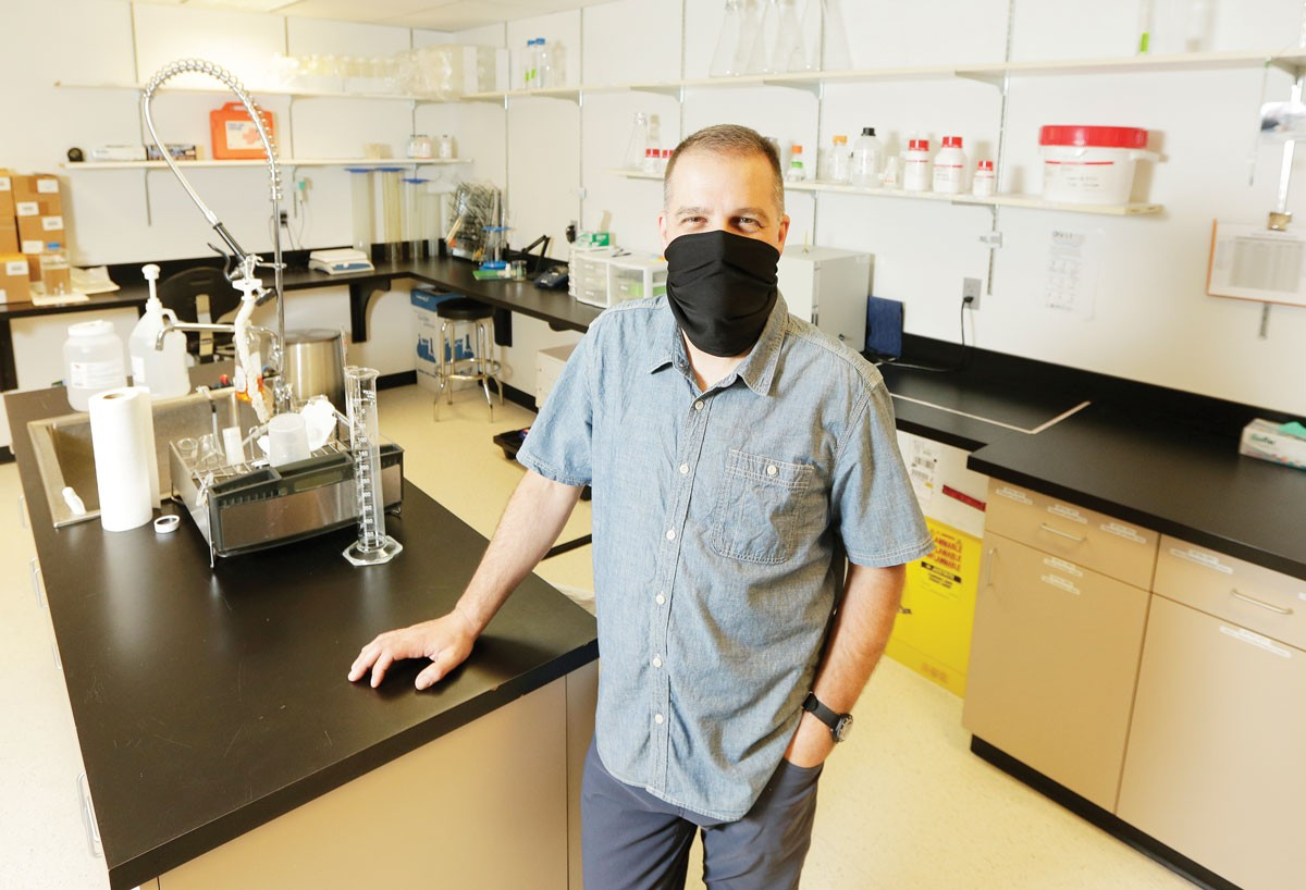 At GenPrime's Spokane lab, Buck Somes says the company's Reader offers improved accuracy in reading and recording coronavirus test results.|young kwak photo
