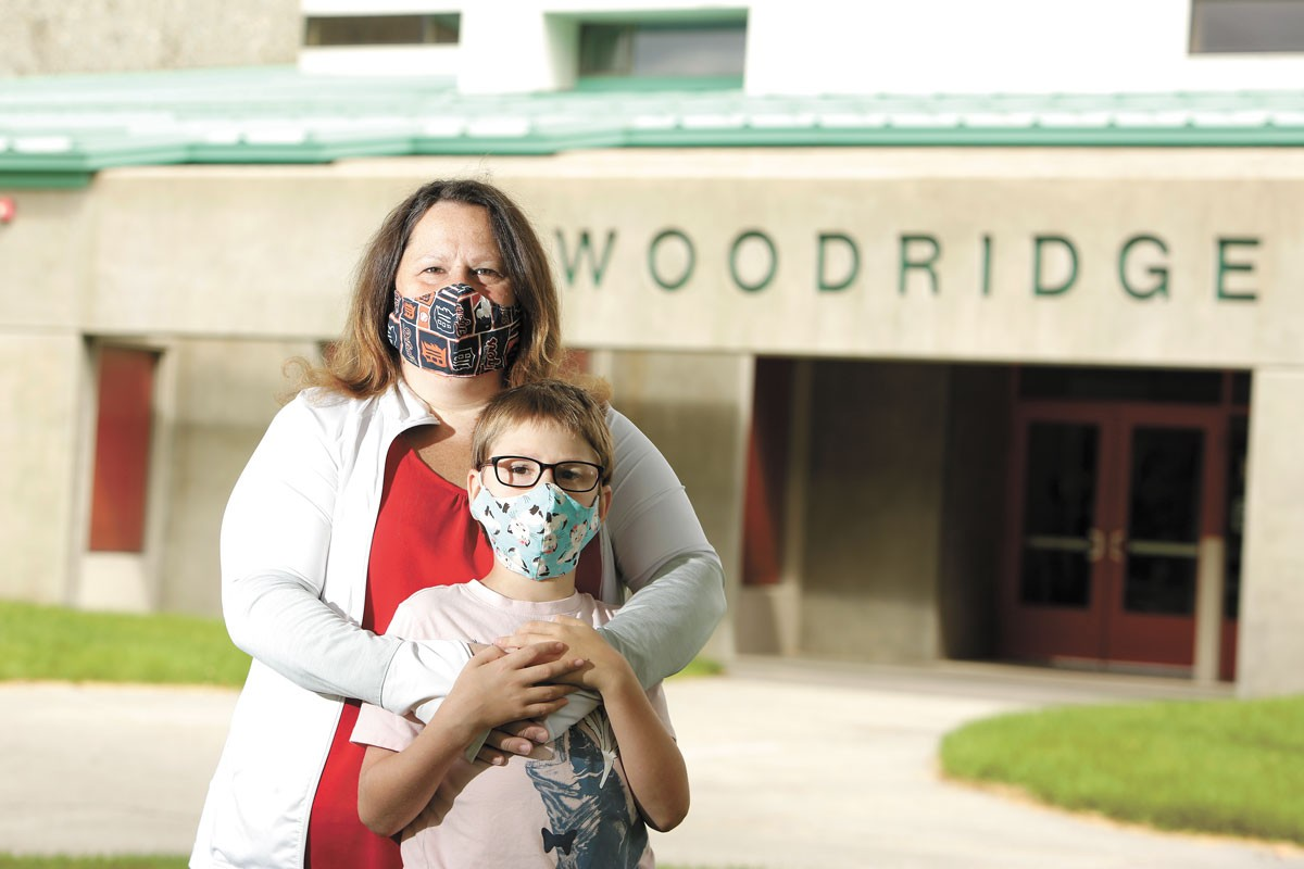 Julie Ancona-Shepard and her 7-year-old son wish in-person school was possible. - YOUNG KWAK PHOTO