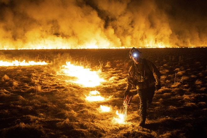 Luke Iott, a Vacaville firefighter, burns a field ahead of a wildfire in Fairfield, Calif., Aug. 19, 2020. Thousands of people were forced to flee their homes in Vacaville, a city of about 100,000 residents near Sacramento, as a combination of uncontrolled fires continued to threaten Northern California on Wednesday. - MAX WHITTAKER/THE NEW YORK TIMES