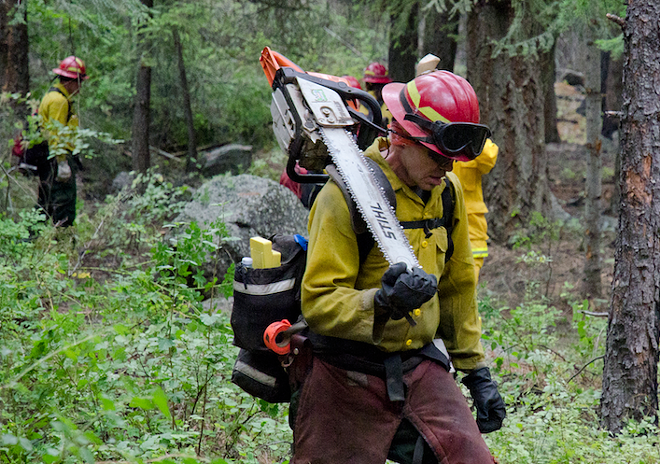 Wildland firefighter working Washington state's Carlton Complex fire in July 2014. - JACOB JONES PHOTO