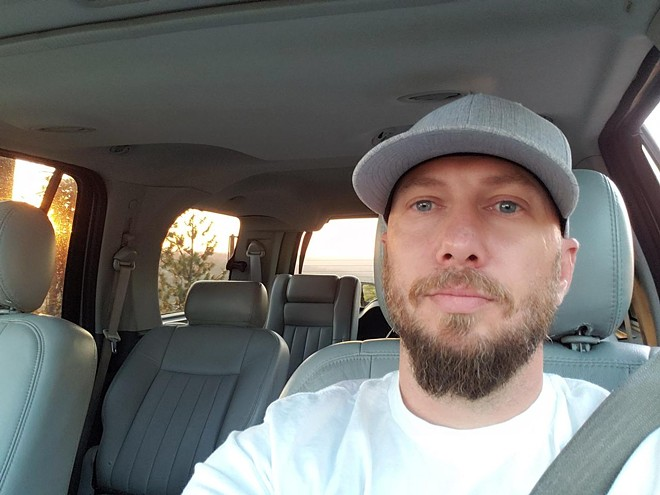 Jeremy Logan, Spokane's co-chair of theDemocratic Socialists of America, claims sheriff's deputies didn't identify themselves when he was picked up on an old warrant. - JEREMY LOGAN PHOTO