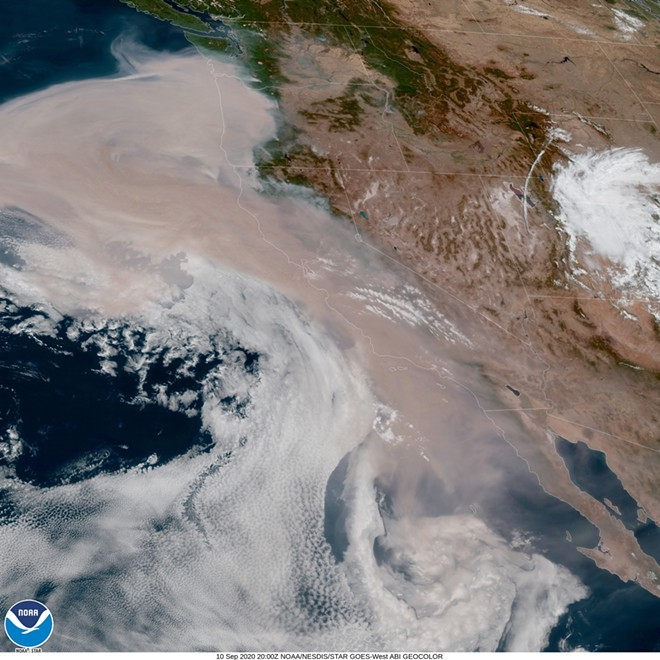 Washington officials shared this image of smoke from West Coast wildfires that is likely to blow inland this weekend, causing air quality to decline. - NOAA