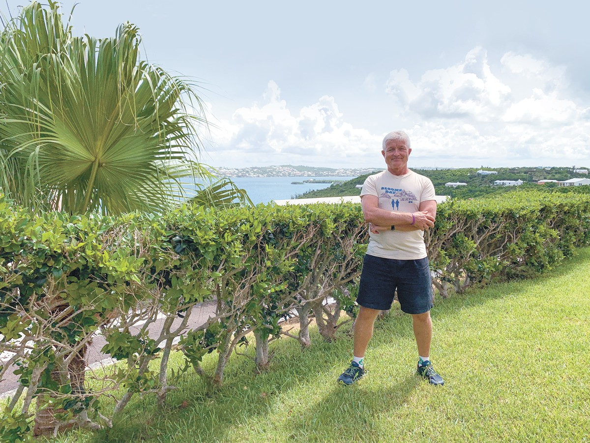 Rory Gorman in his 1980 Bloomsday finisher shirt overlooking Harrington Sound in Bermuda, where he will run Bloomsday this year.
