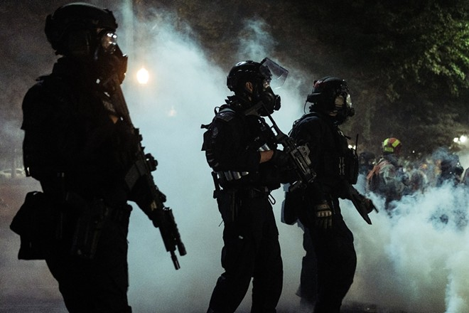 Federal agents during a protest in Portland, Ore., early Tuesday morning, July 28, 2020. After weeks of clashing with protesters, federal forces will soon begin withdrawing from Portland, Gov. Kate Brown of Oregon said Wednesday, July 29, 2020. - MASON TRINCA/THE NEW YORK TIMES