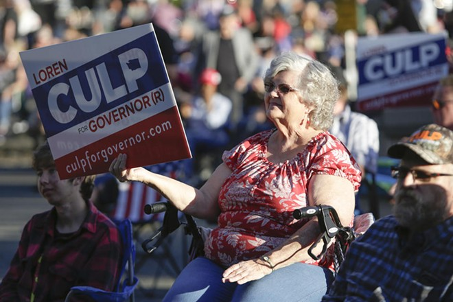 A supporter of Republican gubernatorial candidate Loren Culp attends a free rally and concert in in Arlington, Washington, on Aug. 22, 2020. - JASON REDMOND FOR CROSSCUT
