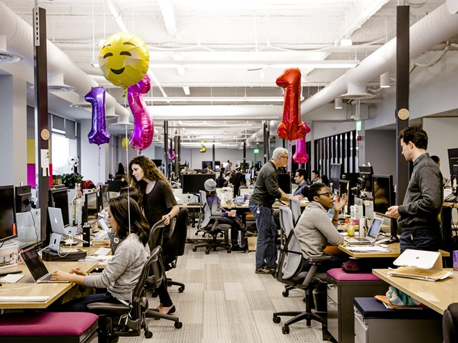 Employees in pre-pandemic times at the headquarters of Slack in San Francisco, Feb. 7, 2017. Most Slack employees have said they would like to have a mix of at-home and office work even after the pandemic subsides. - CARLOS CHAVARRÍA/THE NEW YORK TIMES