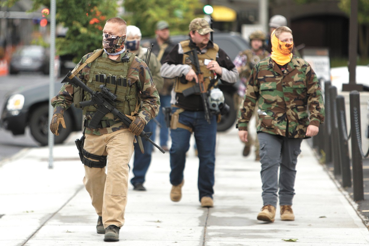 Self-identifying militia members openly carried firearms in downtown Spokane this spring. - YOUNG KWAK PHOTO
