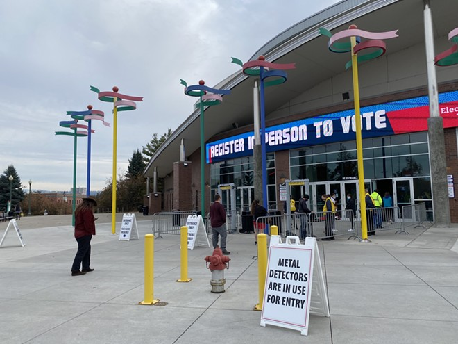 Spokane County voters lined up outside the Spokane Arena all day today to get replacement ballots or register last-minute to vote. Ballots were also accepted at another receptacle at the Arena, in addition to the many other drop boxes around the county, through 8 pm Election Day. - SAMANTHA WOHLFEIL PHOTO