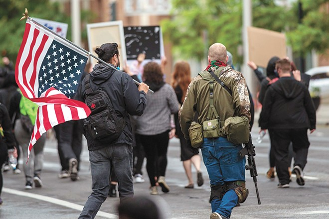 An armed citizen during a protest in downtown Spokane. - DANIEL WALTERS PHOTO