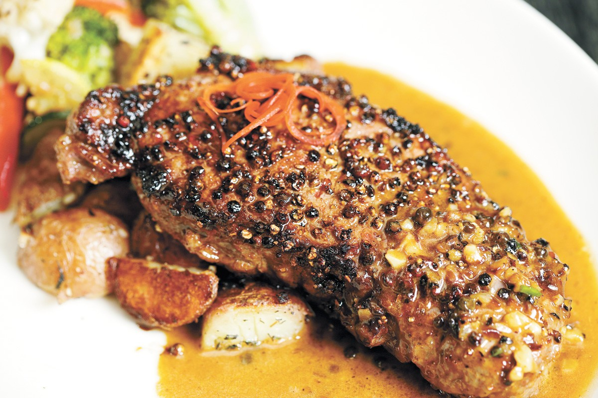 Peppercorn steak is one of six entree options for Max at Mirabeau's Thanksgiving dinner. - YOUNG KWAK PHOTO