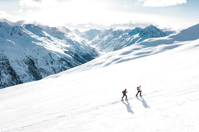Consider giving backcountry skiing a go this year.
