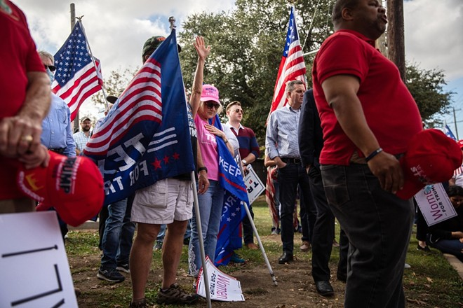 "Supporters of President Donald Trump gather near the Dallas County Elections office in Dallas, during a ""Stop the Steal"" protest on Nov. 9, 2020. Joe Biden promised not only to win, but to ""restore the soul of the nation."" Even with his victory, the deep divisions that animated Trump's tenure show no signs of receding. - TAMIR KALIFA/THE NEW YORK TIMES"