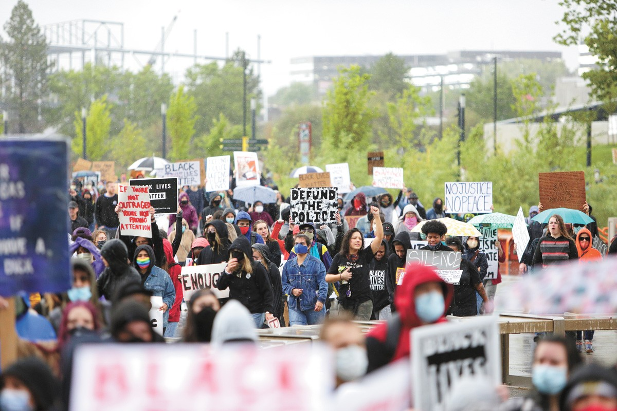 """Most Democrats, from Joe Biden on down, celebrated Black Lives Matter activism while distancing themselves from the """"Defund the Police"""" slogan seen at Spokane protests and across the country. But Republicans tried to tie even moderate Democrats to that slogan anyway. - YOUNG KWAK PHOTO"""