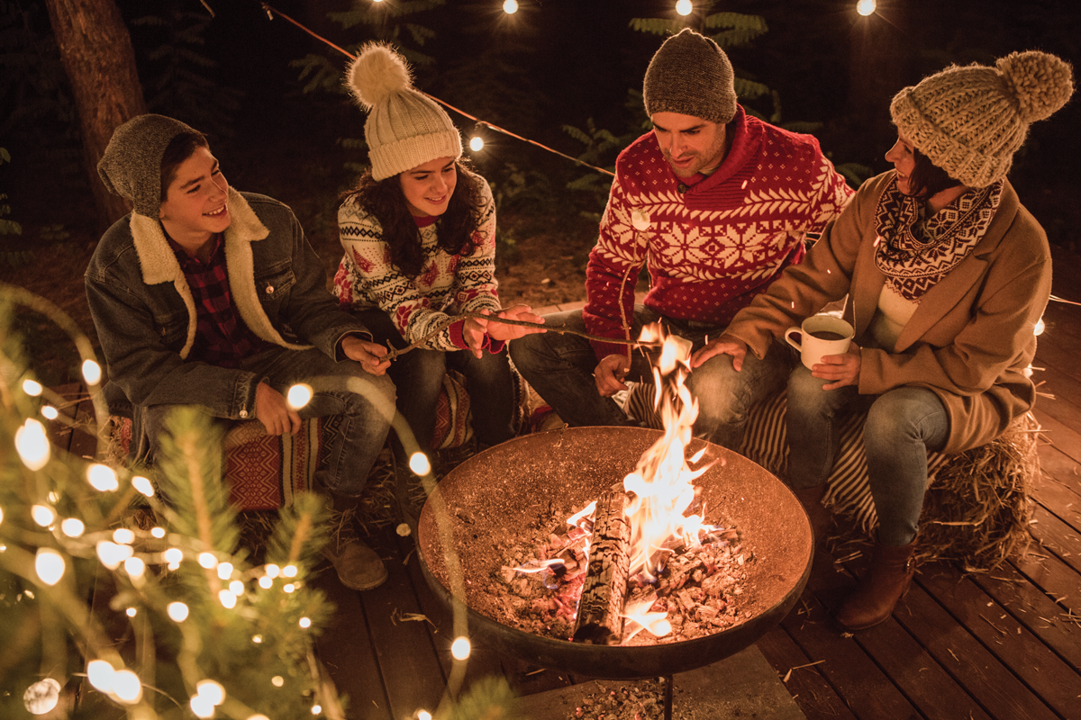 Maintain social distance at your outdoor gathering by seating family members together on one side of your fire.
