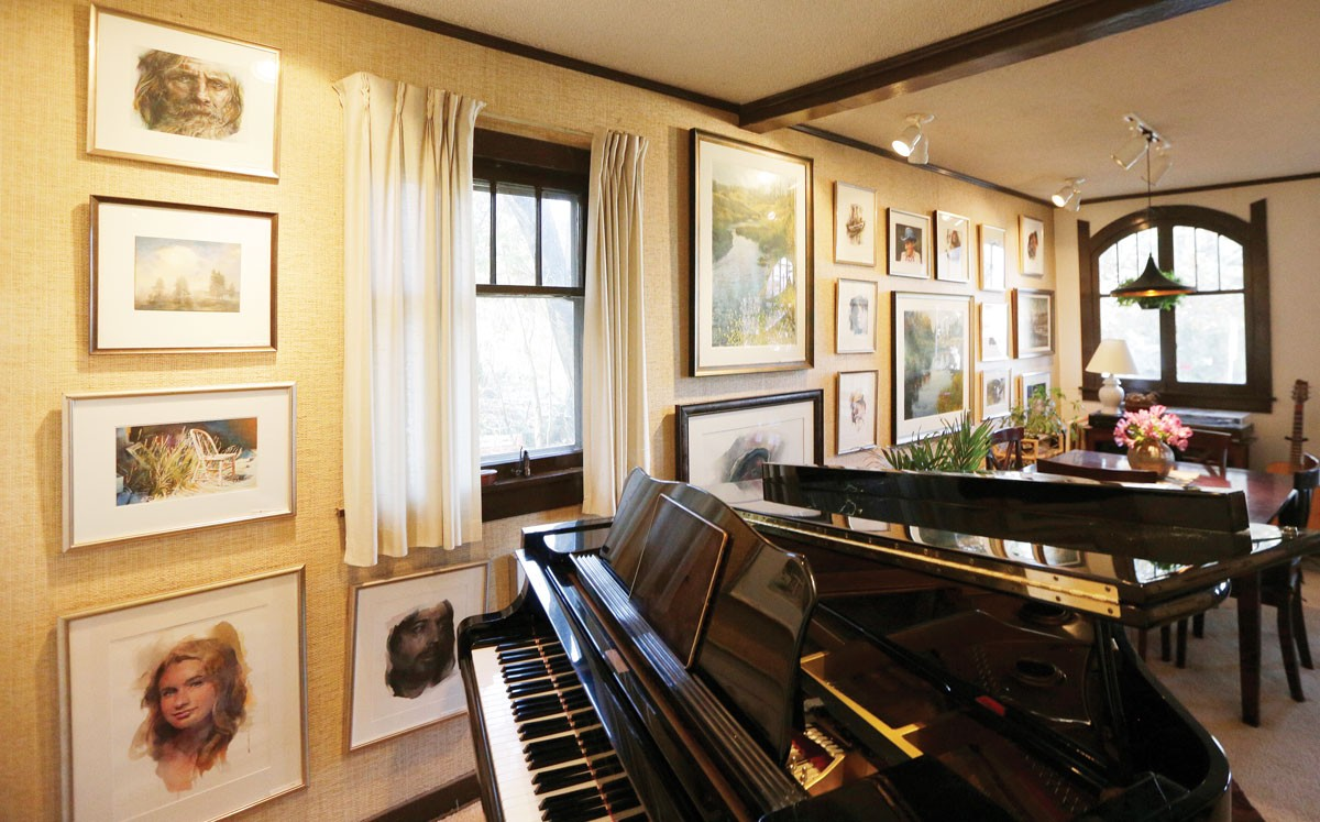 Stan Miller's home is a wall-to-wall gallery of his watercolor paintings. - YOUNG KWAK PHOTO