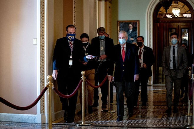 Senate Majority Leader Mitch McConnell (R-Ky.) walks to his office at the Capitol in Washington on Monday, Dec. 14, 2020. - ANNA MONEYMAKER/THE NEW YORK TIMES
