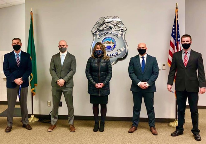 Spokane Mayor Nadine Woodward stands beside the Seattle officers recently hired by the Spokane Police Department. - CITY OF SPOKANE PHOTO