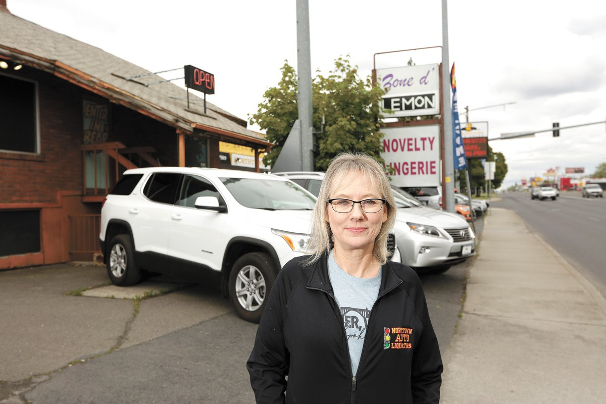 Kim Arrotta, co-owner of Northtown Auto Sales, was frustrated that a next-door business, a sex shop, remained open throughout the spring shutdown. - YOUNG KWAK PHOTO