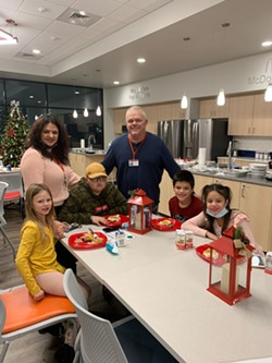 Kids enjoy a meal provided through Care to Nourish on Christmas Day at the Ronald McDonald House of the Inland Northwest. - COURTESY RMHC OF THE INLAND NORTHWEST