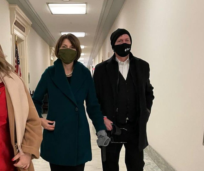 Spokesman-Review Editor-in-Chief Rob Curley sporting a Spokesman-Review-branded mask attends the inauguration as the guest of Rep. Cathy McMorris Rodgers, R-Washington. - PHOTO FROM REP. JENNIFFER GONZÁLEZ'S TWITTER FEED