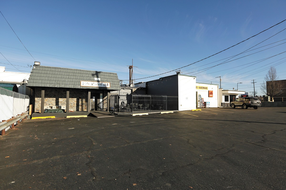 The parking lot of Ichabod's East, a bar in Spokane Valley, where Daniel Jarman was knocked down and beaten. - YOUNG KWAK PHOTO