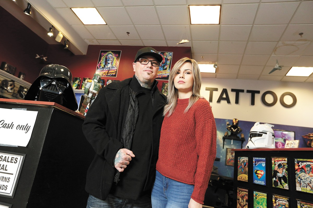 Joe Riley and his wife Shalee in the tattoo shop that he owns. - YOUNG KWAK PHOTO