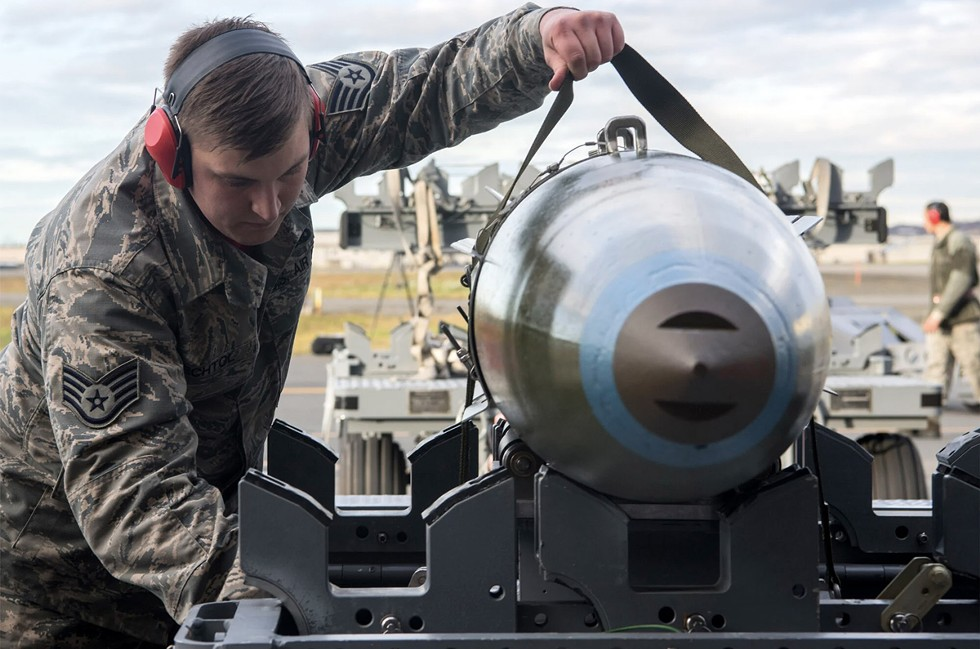 Taylor Bechtol, then an Air Force staff sergeant, with munition at Joint Base Elmendorf-Richardson in Alaska on Oct. 26, 2018. Bechtol has been linked to the Boogaloo Bois. - JONATHAN VALDES/USAF