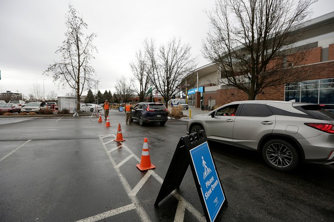 Cars arrive at the mass vaccination center at the Spokane Arena on Monday, Feb. 1. - YOUNG KWAK PHOTO
