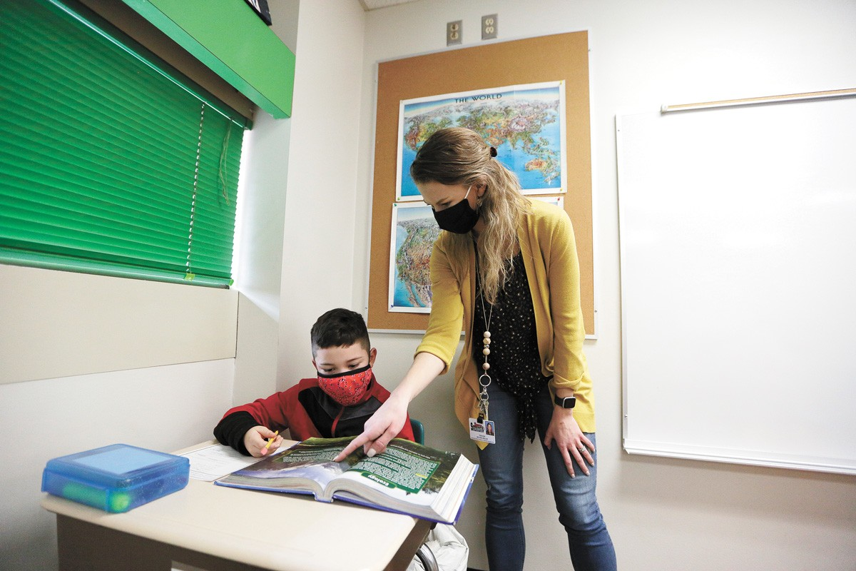 Sheridan Elementary fourth-grade teacher Melissa Beeler works with 10-year-old student Elijah. - YOUNG KWAK PHOTO