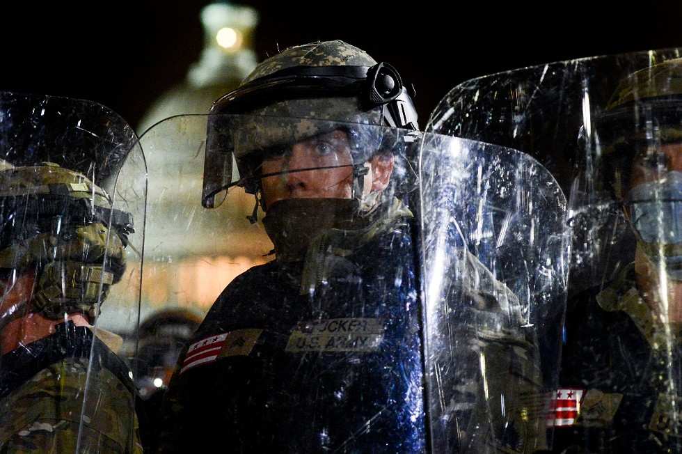 A member of the National Guard facing off with a mob of pro-Trump supporters in front of the Capitol in Washington, Jan. 6, 2021. New details about what authorities anticipated on Jan. 6 highlight failures to grasp the degree of the threat from pro-Trump right-wing extremists. - KENNY HOLSTON/THE NEW YORK TIMES