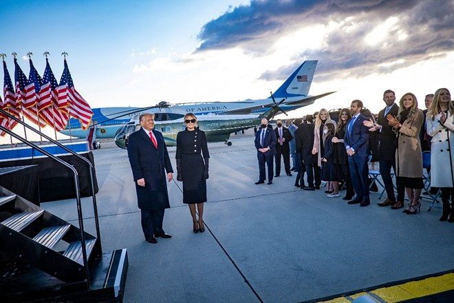 Then-President Donald Trump and first lady Melania Trump at Joint Base Andrews, Md., before boarding Air Force One for the last time in office, Jan. 20, 2021. - PETE MAROVICH/THE NEW YORK TIMES