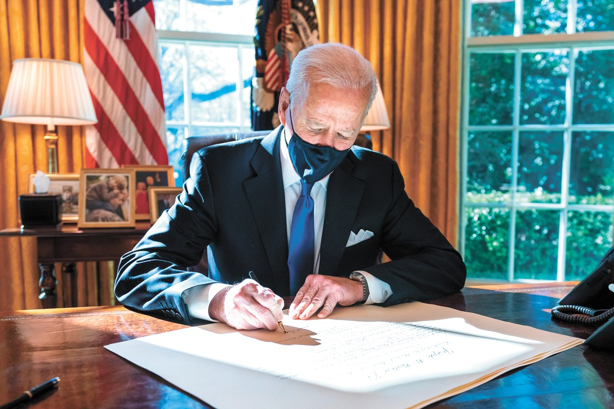"The author argues that President Biden is ""an unlikely action hero in an era of expected inaction."" - OFFICIAL WHITE HOUSE PHOTO"