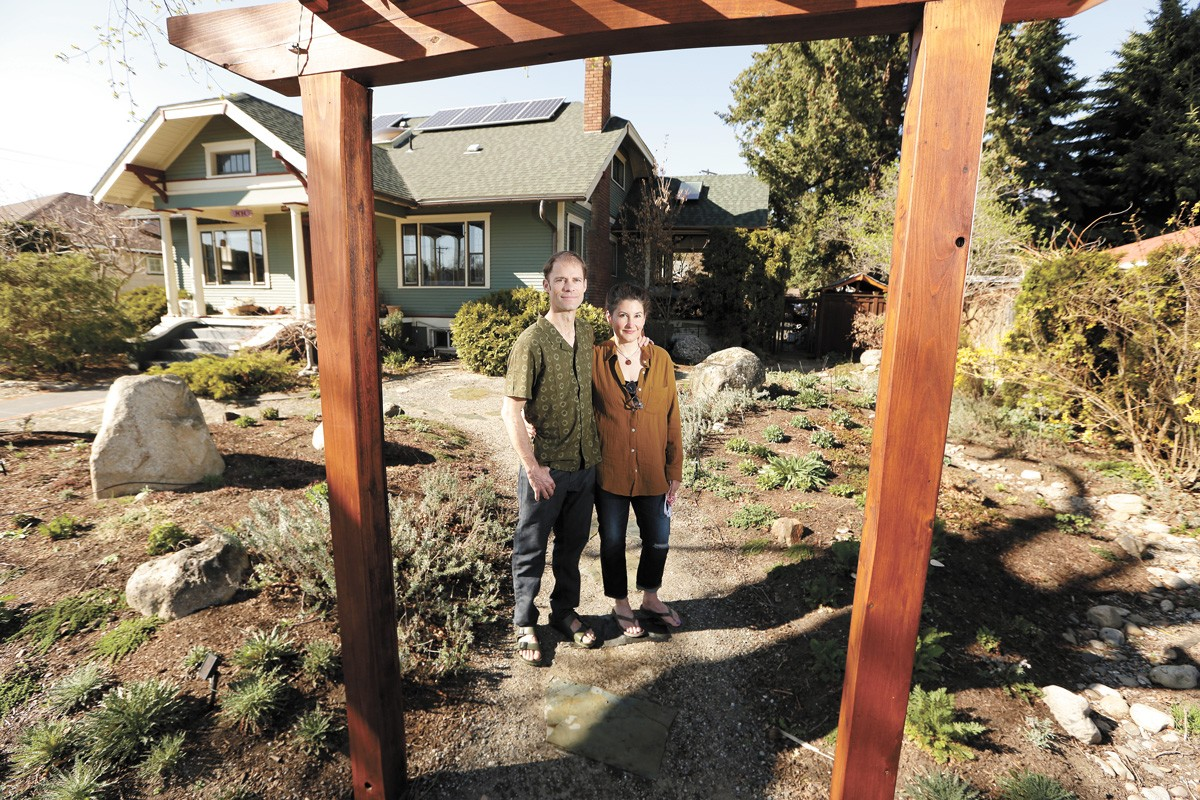 Ethan and Kirsten Angell replaced their lawn with water-efficient plants as part of the SpokaneScape program. - YOUNG KWAK PHOTO
