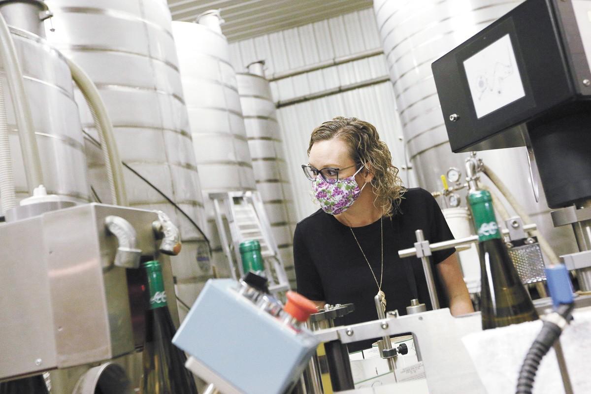 Latah Creek Winery's Natalie Barnes is anxious to talk wine again. - YOUNG KWAK PHOTO