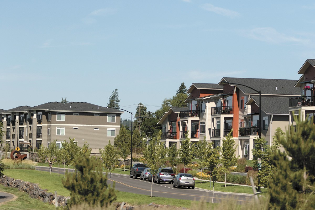 Kendall Yards is praised for being a walkable neighborhood, but its townhomes and cottages are illegal to build in much of Spokane. - YOUNG KWAK PHOTO