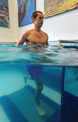"""Running on an underwater treadmill at Spokane's Physical Therapy Associates is popular with patients. """"Most people are immediately in a good mood,"""" says therapist Dylan Palmer. - DENIS KALAMAR PHOTO"""