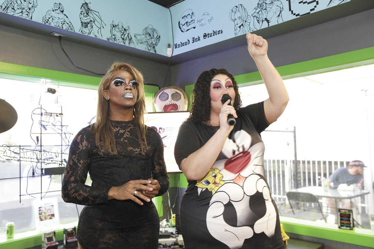 Chelle Crotinger, right, who performs in drag as Tirrany Reigns, and Sativa Heather Black St. James at a show hosted by GeeksNGlory Gaming Bar in Spokane Valley last Saturday. - YOUNG KWAK PHOTO