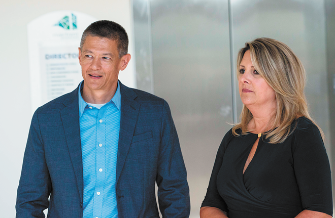 Vacancies and turnover in high-level positions have made City Spokesman Brian Coddington, left, a particularly influential figure in Nadine Woodward's administration. - DANIEL WALTERS PHOTO