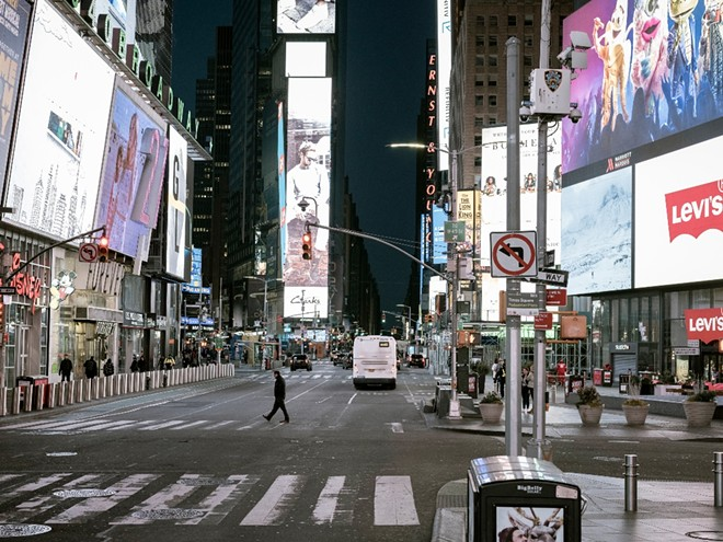 Pedestrians in Times Square in Manhattan on March 11, 2020, as the lockdown began in New York. Employers cut 22 million jobs in March and April. - ASHLEY GILBERTSON/THE NEW YORK TIMES