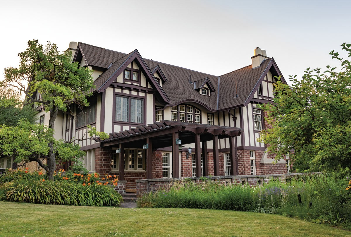 Built in 1912, the Nuzum House was designed by Kirtland Cutter and Karl Malmgren in the American Tudor Revival style, a nod to English architecture of the 1600s. In addition to the home's classic half-timbering with stucco infill, elements of the style include the variegated red bricks, eaves with exposed rafters and groups of vertical pane windows. The original homeowner Richard Nuzum was a celebrated criminal defense attorney in Spokane. - ERICK DOXEY PHOTO