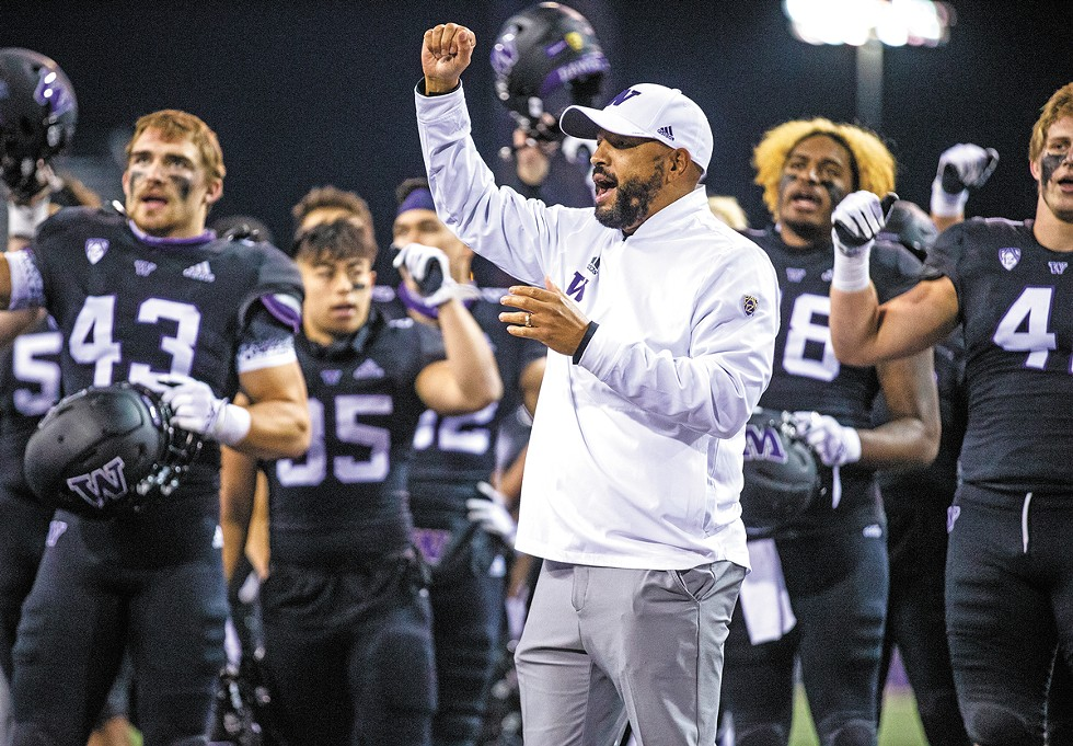 """Jimmy Lake leading the cheer after a 44-27 victory over Arizona in an empty Husky Stadium on Nov. 21, 2020. """"I'm really excited about this team,"""" says Lake, looking ahead to the start of the 2021 season against Montana. """"We're unified, and now we just have to go show Husky Nation — and the whole nation."""" - LINDSEY WASSON PHOTO/RED BOX PICTURES"""