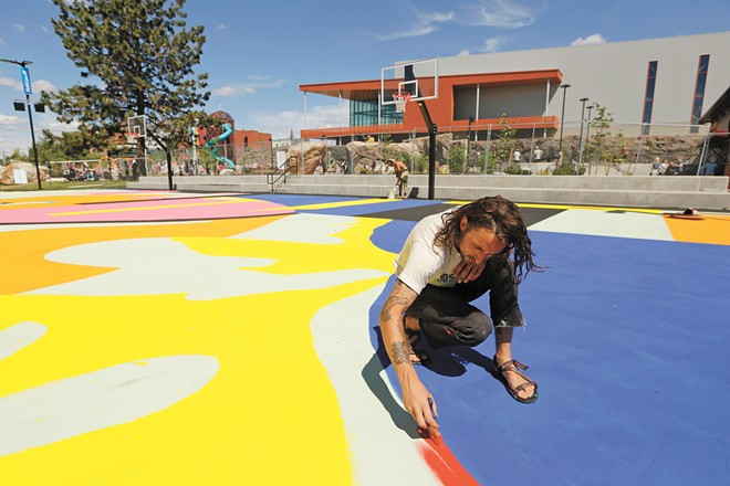 Muralist Joshua Martel and his team braved record-setting heat to finish his artwork by the June 26 grand opening. - YOUNG KWAK PHOTO