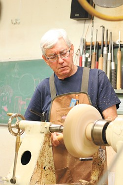 Ed Krumpe works on a project at the Palouse Woodworkers Collective shared studio. - CARRIE SCOZZARO PHOTO