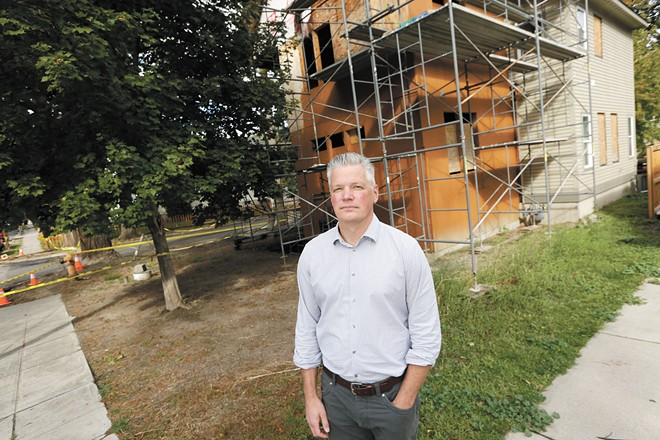 Todd Beyreuther, president of Spokane's Plan Commission, stands in front of a single-family home near Manito Park. The building used to be a duplex, but because of the city's restrictive zoning laws, the owner would not be allowed to convert the property back into a duplex. - YOUNG KWAK PHOTO